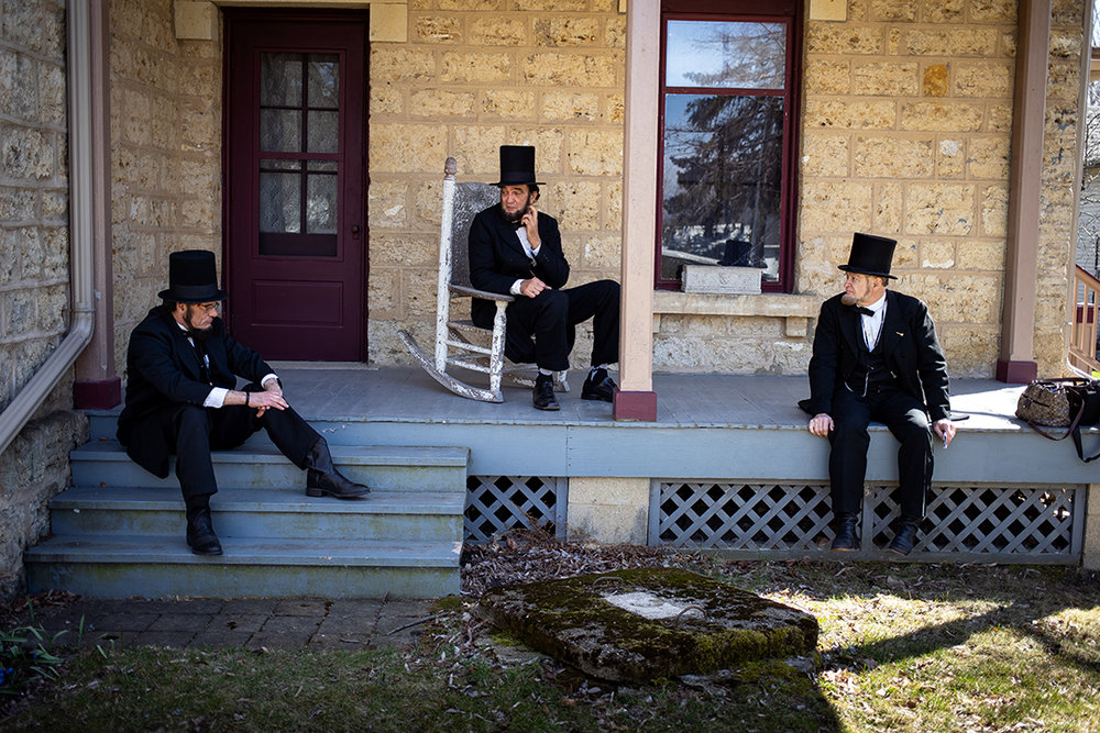 Whit McMahan, left, Ron Carley and Murray Cox take a break at the Stephenson County Historical Museum during the Association of Lincoln Presenters annual convention Friday, April 20, 2018 in Freeport, Ill. [Rich Saal/The State Journal-Register]