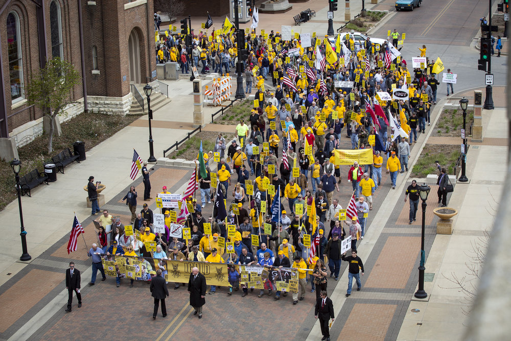 A crowd estimated at 2,800 people walk in the annual IGOLD (Illinois Gun Owners Lobby Day) march to the Capitol Wednesday, April 25, 2018  in Springfield, Ill. [Rich Saal/The State Journal-Register]