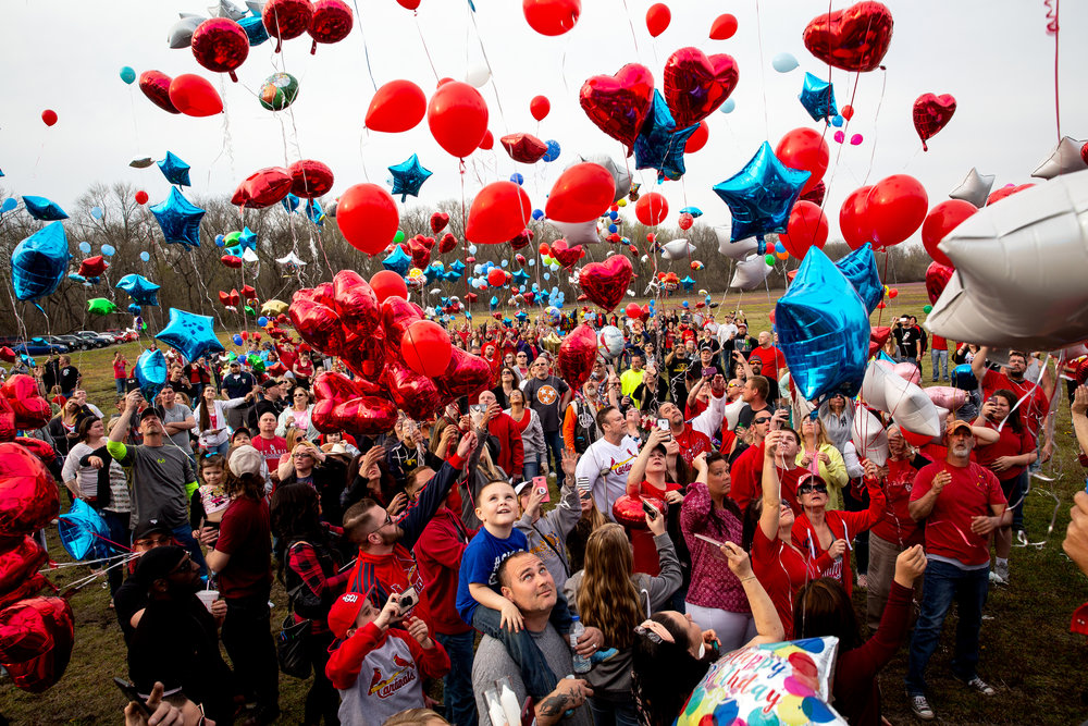 Hundreds of balloons were launched from Riverside Park in honor of Shane ShmodieÕs 30th birthday by friends supporting his family Wednesday, April 25, 2018 in Springfield, Ill. Shomidie went missing after a kayaking accident on the Sangamon River April 23. Search efforts are continuing. [Rich Saal/The State Journal-Register]