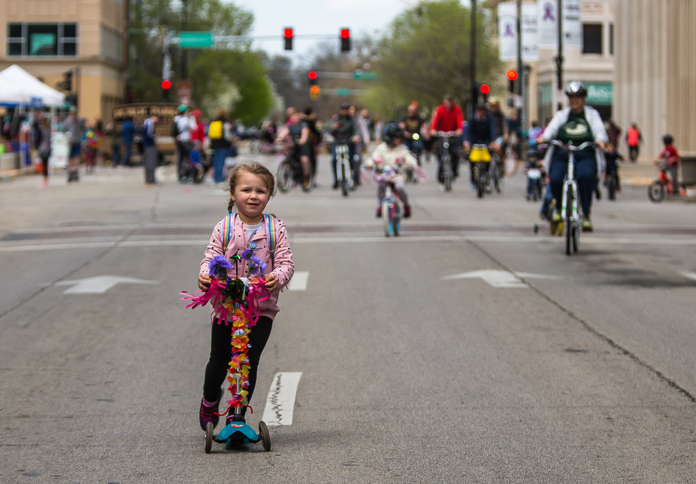 "Ellie Sabo, 4, rides a scooter down Sixth Street during the Downtown Open Streets event, Saturday, April 28, 2018, in Springfield, Ill. Downtown Open Streets was an event put on by Downtown Springfield, Inc. and sponsored by Memorial Health System, and created a ""paved park"" by temporarily closing certain downtown streets and holding demonstrations promoting recreation and healthier living. [Justin L. Fowler/The State Journal-Register]"