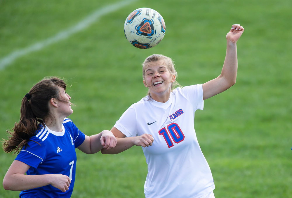 Pleasant Plains's Mandy Watson (10) hits a header against Lutheran's Julie Elmore (7) in the second half during the championship game of the Pleasant Plains Girls Soccer Invite at Pleasant Plains High School, Saturday, April 28, 2018, in Springfield, Ill. [Justin L. Fowler/The State Journal-Register]