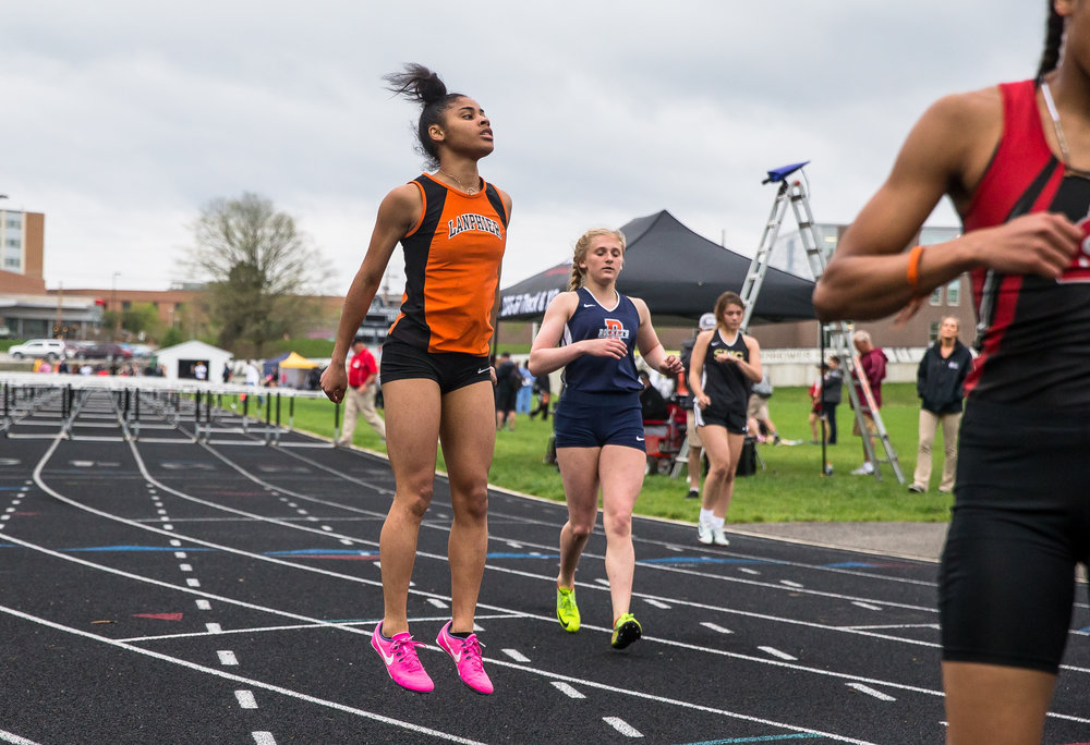 Lanphier's N'dia Jackson celebrates after winning the 100m Hurdles setting a new personal record with a time of 15.11 during the Girls CS8 Track & Field Meet at Eisenhower High School, Thursday, May 3, 2018, in Springfield, Ill. [Justin L. Fowler/The State Journal-Register]