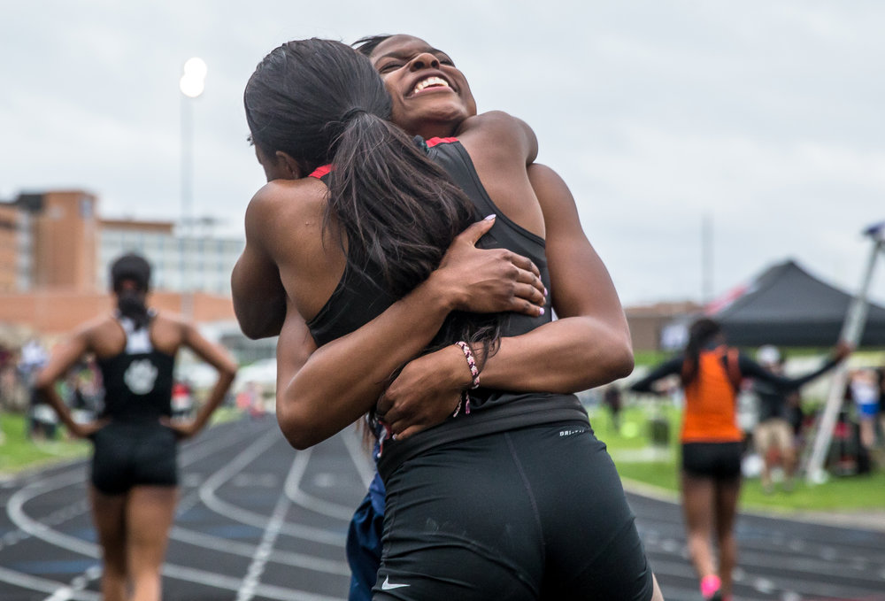 Southeast's Serena Bolden hugs Springfield's Ozzy Erewele after she was defeated by Erewele in the 100m Dash during the Girls CS8 Track & Field Meet at Eisenhower High School, Thursday, May 3, 2018, in Springfield, Ill. [Justin L. Fowler/The State Journal-Register]
