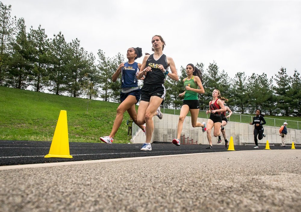 Southeast's Sydney Huffman and Sacred Heart-Griffin's Mikayla Hady are side by side going into the second lap of the 800m Run during the Girls CS8 Track & Field Meet at Eisenhower High School, Thursday, May 3, 2018, in Springfield, Ill. [Justin L. Fowler/The State Journal-Register]