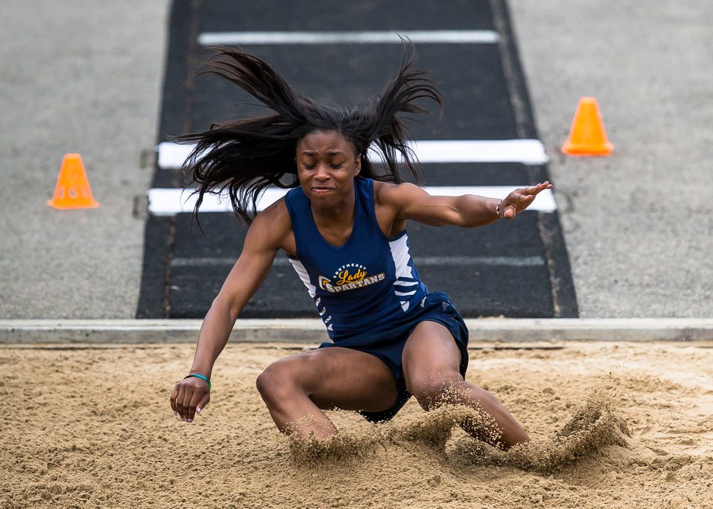 Southeast's Serena Bolden hits the sand while competing in the Long Jump during the Girls CS8 Track & Field Meet at Eisenhower High School, Thursday, May 3, 2018, in Springfield, Ill. Bolden won the event with a jump of 20-01.25. [Justin L. Fowler/The State Journal-Register]