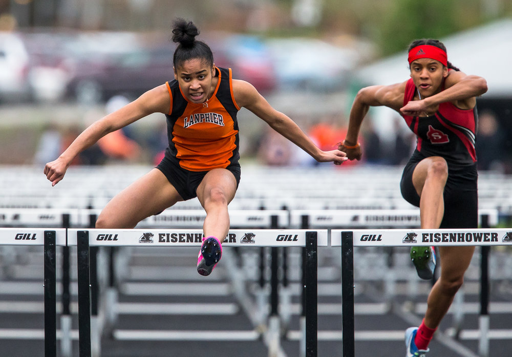 Lanphier's N'dia Jackson wins the 100m Hurdles setting a new personal record with a time of 15.11 during the Girls CS8 Track & Field Meet at Eisenhower High School, Thursday, May 3, 2018, in Springfield, Ill. [Justin L. Fowler/The State Journal-Register]
