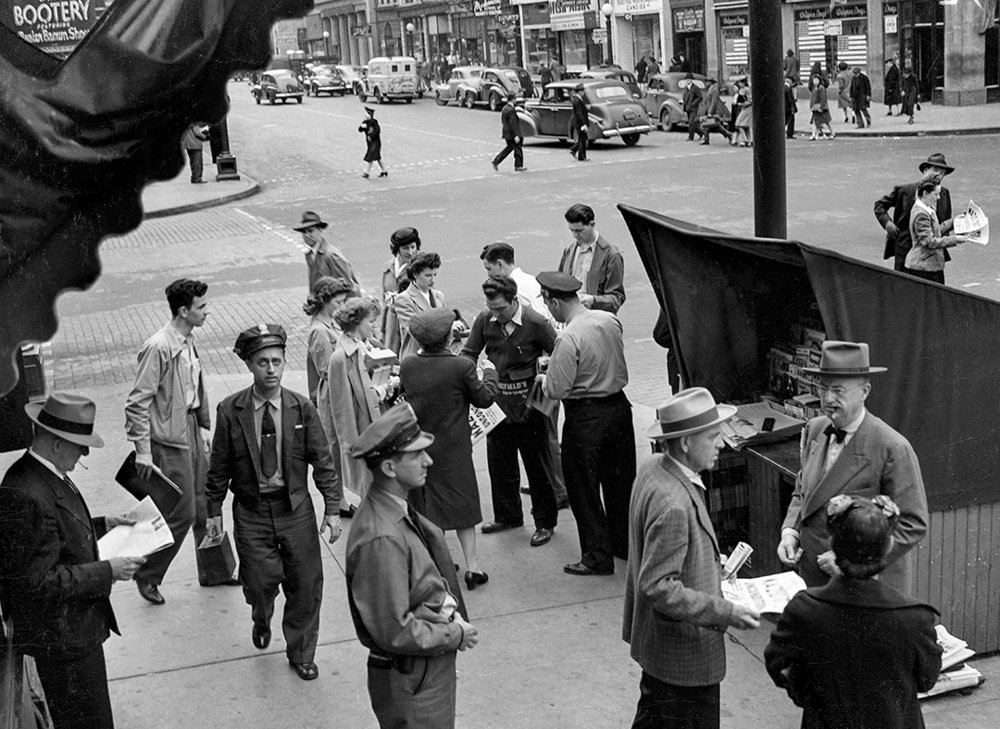 Nazis surrender in Europe, people buying newspapers from vendor at Fifth and Monroe streets, May 7, 1945. File/The State Journal-Register