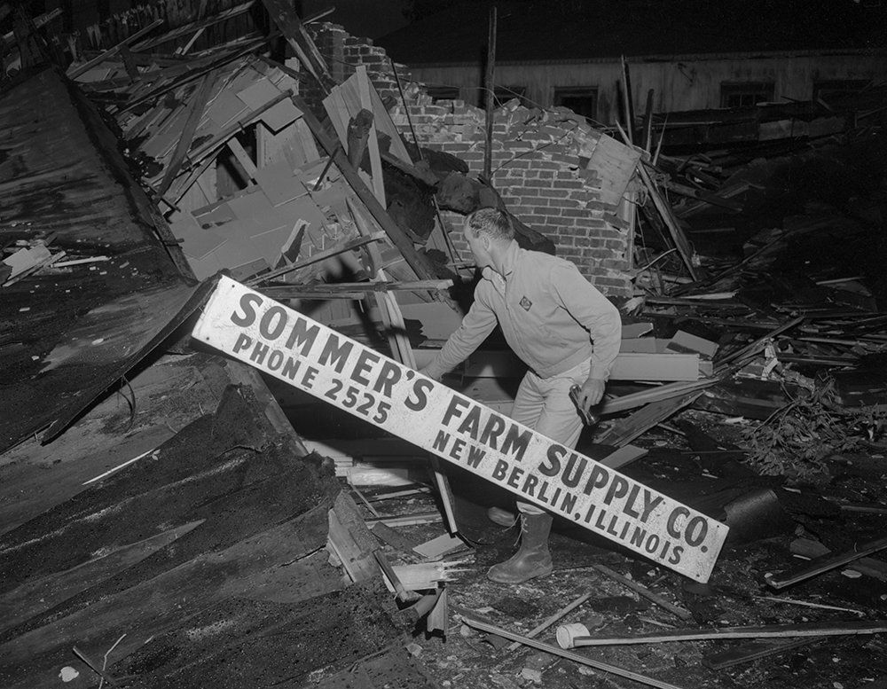 Frank Sommers inspects damage to his business in New Berlin after tornado struck the town May 14, 1961. File/The State Journal-Register