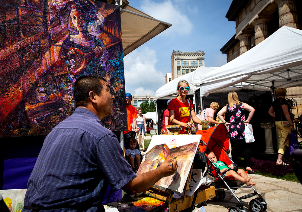 Jinsheng Song of Fort McCoy, Fla. works on a painting of the Old State Capitol next to his booth during the downtown art fair of the same name Saturday, May 19, 2018 at the Old State Capitol in Springfield, Ill. [[Rich Saal/The State Journal-Register]