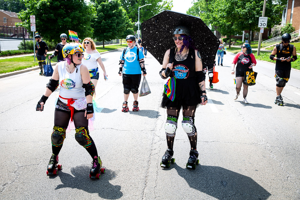 Regina Bridges, left, and Summer Bath, members of the Midstate Mayhem roller derby team, skated in the Springfield PrideFest parade on Fifth Street Saturday, May 19, 2018 in Springfield, Ill. [Rich Saal/The State Journal-Register]