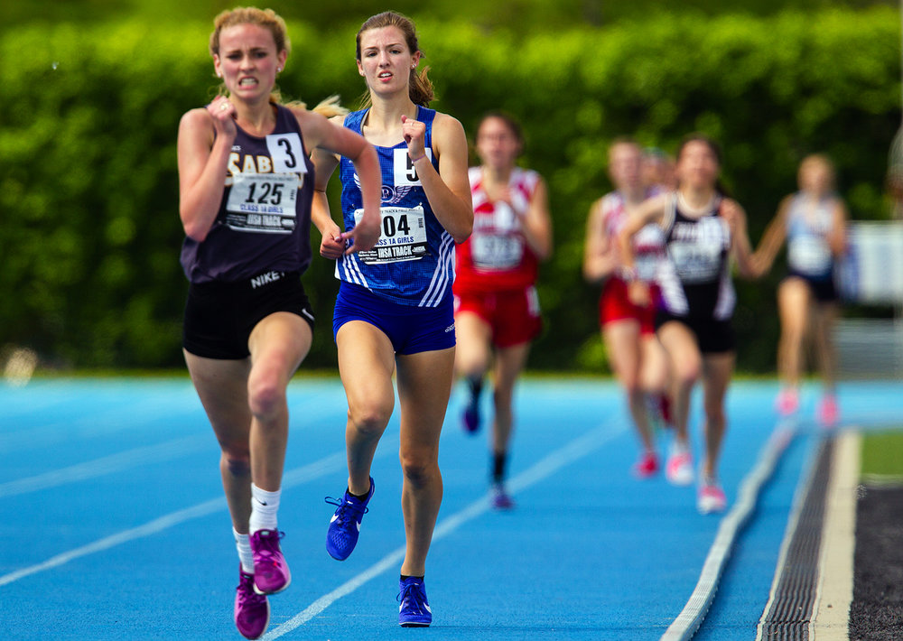 Pleasant Plains' Caroline Jachino tails Champaign Judah Christian's Laura Krasa in the Class A 3,200 meter run during the IHSA Track and Field State Finals at O'Brien Field in Charleston, Ill., Saturday, May 19, 2018. Jachino finished second. [Ted Schurter/The State Journal-Register]