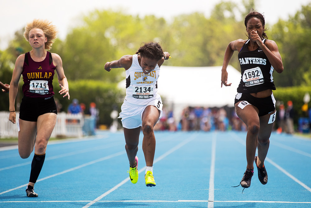 Decatur Eisenhower's Tina Martin edges Southeast's Serena Bolden for the win by .06 seconds in the Class 2A 100 meter dash at the IHSA Track and Field State Finals at O'Brien Field in Charleston, Ill., Saturday, May 19, 2018.  [Ted Schurter/The State Journal-Register]