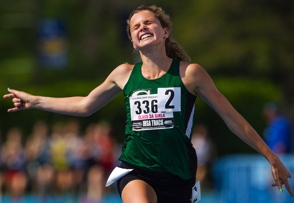Glenbard West's Katelynne Hart celebrates as she crosses the finish line first in the Class 3A 1,600 meter run during the IHSA Track and Field State Finals at O'Brien Field in Charleston, Ill., Saturday, May 19, 2018. Hart has never lost a state final in the distance events as a high schooler. Her time of 4:47.36 set a new Illinois record and is a top seven time in the nation. [Ted Schurter/The State Journal-Register]