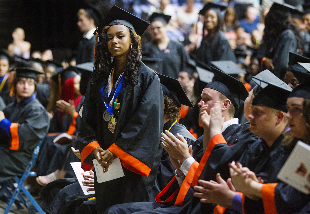 Students who are enlisting in the armed services stand for recognition during the 99th Commencement for Lanphier High School at the Bank of Springfield Center Saturday, June 2, 2018. [Ted Schurter/The State Journal-Register]