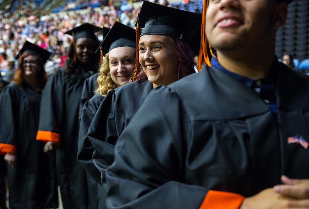 Molly Grider is all smiles as she waits in line to get her diploma during the 99th Commencement for Lanphier High School at the Bank of Springfield Center Saturday, June 2, 2018. [Ted Schurter/The State Journal-Register]
