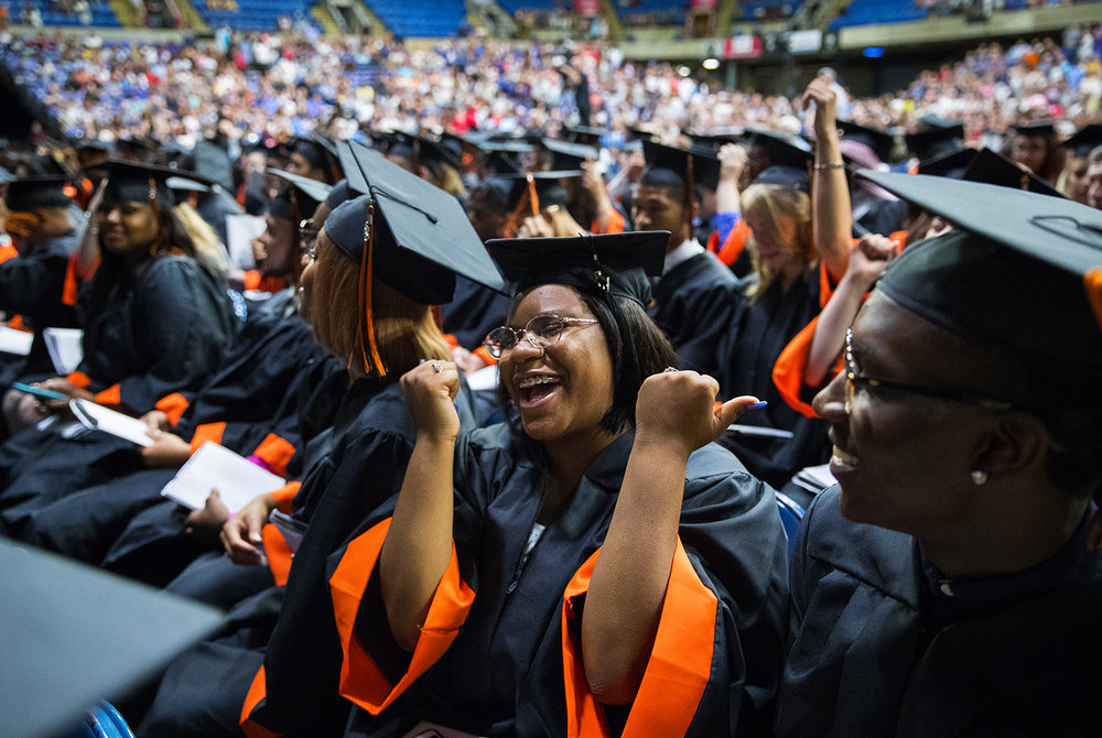 Jasmine Clark celebrates as the 99th Commencement for Lanphier High School at the Bank of Springfield Center winds down Saturday, June 2, 2018. [Ted Schurter/The State Journal-Register]