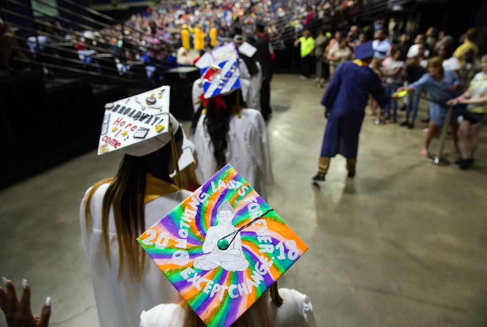 Beth Bangert sports a colorful hat as she waits in line during the 51st Commencement for Springfield Southeast High School at the Bank of Springfield Center Saturday, June 2, 2018. [Ted Schurter/The State Journal-Register]
