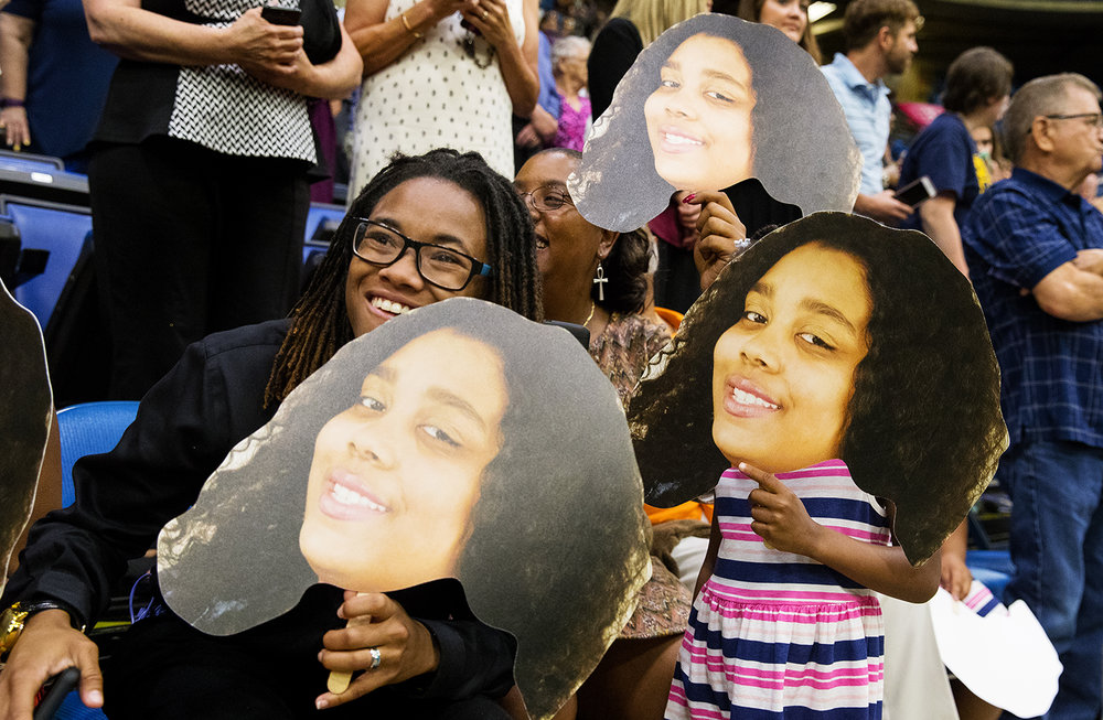 Friends and familoy of Trinity Thomas hold up her image as she processes in for the 51st Commencement for Springfield Southeast High School at the Bank of Springfield Center Saturday, June 2, 2018. [Ted Schurter/The State Journal-Register]