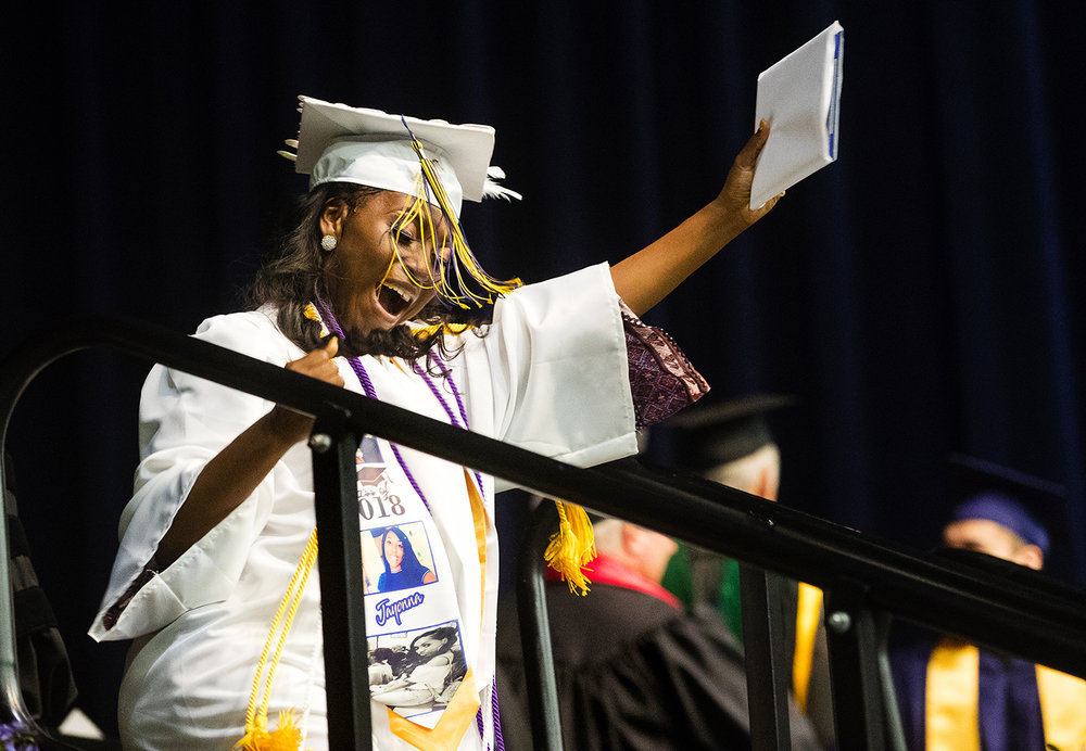 Jayonna Craig celebrates after getting her diploma during the 51st Commencement for Springfield Southeast High School at the Bank of Springfield Center Saturday, June 2, 2018. [Ted Schurter/The State Journal-Register]