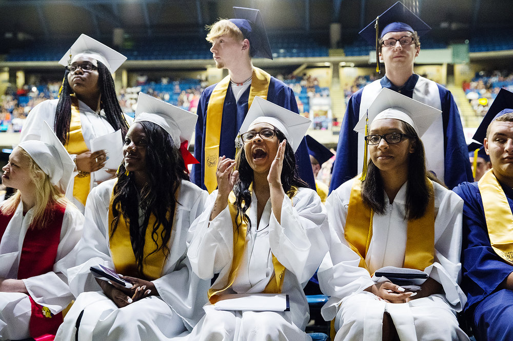 Alayah Austin cheers for a classmate during the 51st Commencement for Springfield Southeast High School at the Bank of Springfield Center Saturday, June 2, 2018. [Ted Schurter/The State Journal-Register]