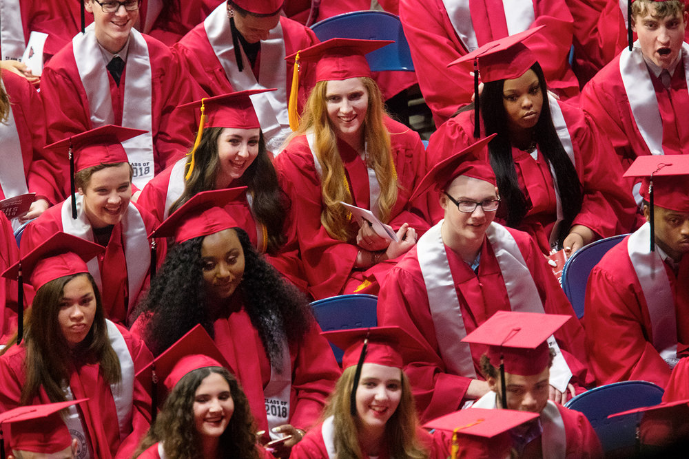 Studetnts laugh as Freya Jennison and Jack Sandstrom give the Class Address during Commencement for Springfield High School at the Bank of Springfield Center Saturday, June 2, 2018. [Ted Schurter/The State Journal-Register]