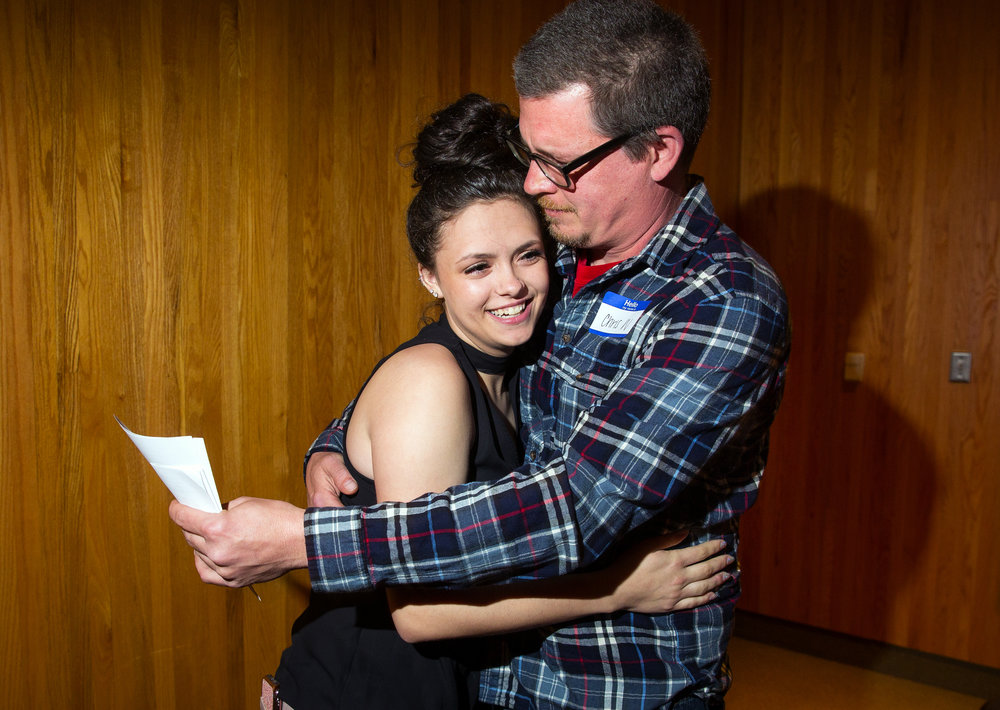 Gwen Wisecup, a senior at Southeast High School who works closely with the Prairie Center Against Sexual Assault, hugs her dad Chris after she was named the 2018 Top Teen Award winner during a ceremony Monday, April 30, 2018 at the State Journal-Register. [Ted Schurter/The State Journal-Register]