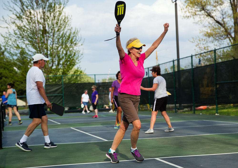 Paula Simmons celebrates after scoring a point in her first ever game during the Springfield Park District's Pickleball for Beginners program at the Iles Park pickleball courts Wednesday, May 2, 2018. The program runs each Wednesday evening through September 26, 2018. Paddles and balls are provided. [Ted Schurter/The State Journal-Register]
