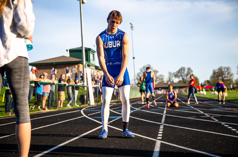 Auburn's Greg Downs tries to catch is breath after winning the Boys 400m Run with a time of 51.58 during the Sangamon County Track & Field Meet at Athens High School, Friday, May 4, 2018, in Athens, Ill. [Justin L. Fowler/The State Journal-Register]