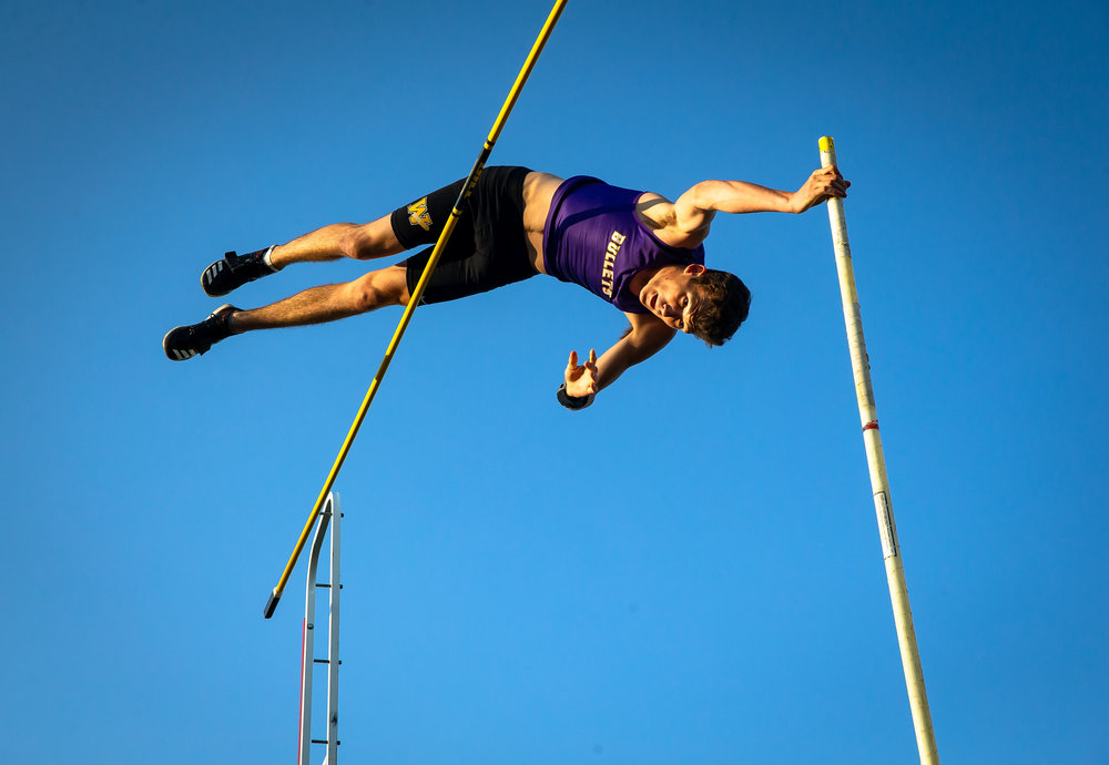 Williamsville's Cameron Witts hits the bar as he attempts to clear 15' 1.00 after winning the Boys Pole Vault clearing 14' 6.00 during the Sangamon County Track & Field Meet at Athens High School, Friday, May 4, 2018, in Athens, Ill. [Justin L. Fowler/The State Journal-Register]