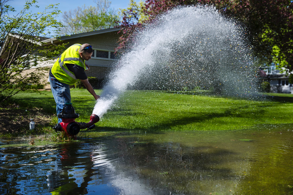 City Water, Light and Power employee Steve Hammann collects a sample of water to check it's visual clarity during annual fire hydrant testing in Springfield Monday, May 7, 2018. Testing is expected to be ongoing until August to ensure fire hydrants are operating efficiently for fire protection purposes. Because water can become temporarily discolored in service areas located in the vicinity of the hydrant test, CWLP suggests delaying clothes washing until the tap water runs clear to avoid discoloration. [Ted Schurter/The State Journal-Register]