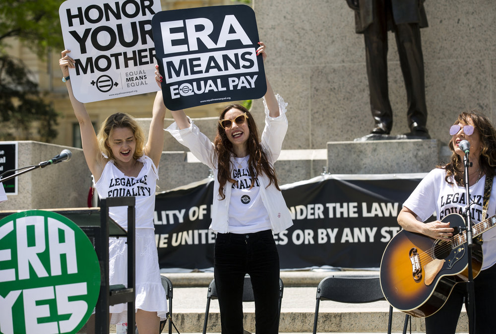 Actress and model Lizzy Jagger, center, the eldest daughter of Mick Jagger and Jerry Hall, joins others at a rally in support of the Equal Rights Amendment on the steps of the Capitol Tuesday, May 8, 2018 in Springfield, Ill. Rally participants urged the Illinois House to pass a joint resolution ratifying the constitutional amendment. [Rich Saal/The State Journal-Register]