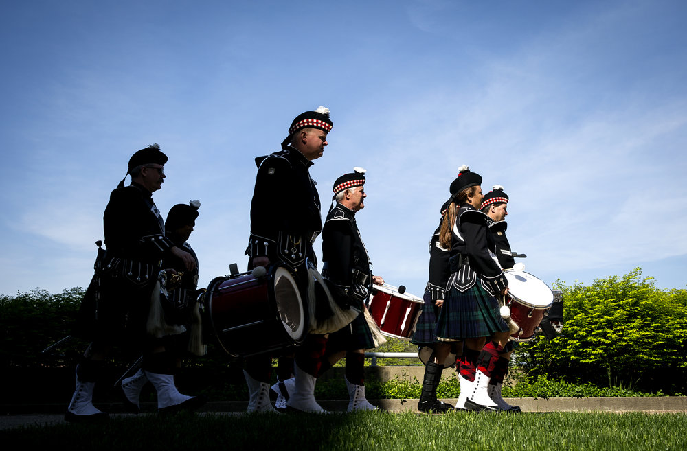 Members of the Associated Firefighters of Illinois Honor Guard bagpipes walk toward the start of the 25th Annual Illinois Fallen Firefighter Memorial Tuesday, May 8, 2018 at the Firefighter's Memorial on the Capitol grounds in Springfield, Ill. Firefighters and their families from across the state gathered in Springfield to remember those who have given their lives in the line of duty, which this year include firefighters John ÒMikeÓ Cummins of the Homer Fire Protection District and Lawrence Matthews from the Village of Dolton Fire Department. Their families were presented with the Duty Death Gold Badge by state Fire Marshal Matt Perez. [Rich Saal/The State Journal-Register]