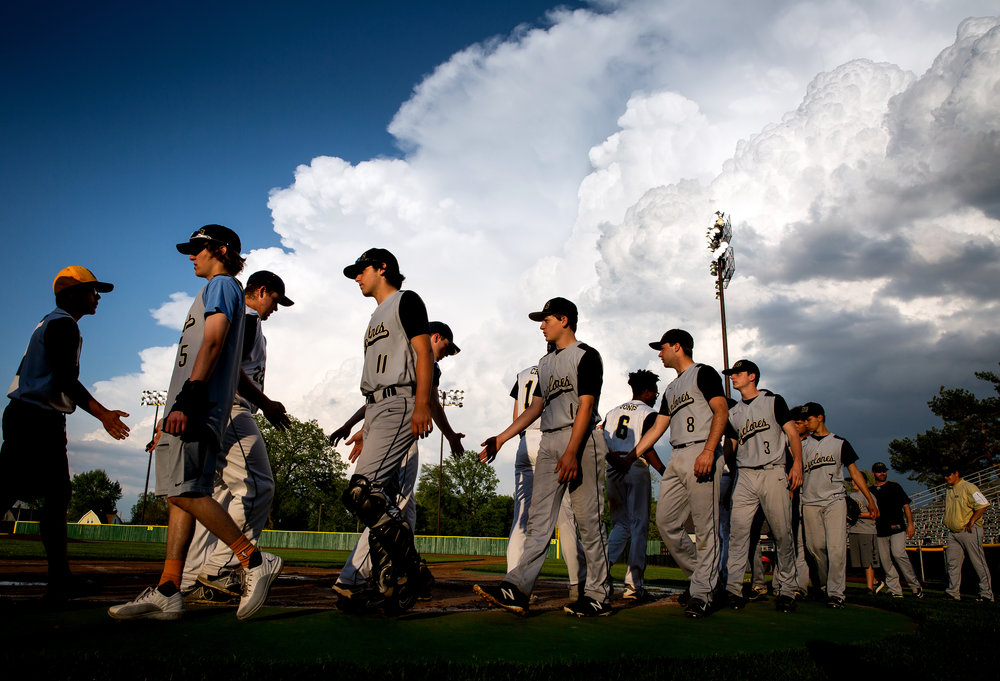 The Sacred Heart-Griffin Cyclones and the Southeast Spartans shake hands after their City Series game was called in the sixth inning because of rain Wednesday, May 9, 2018 at Robin Roberts Stadium. Southeast got the win, 3-2, but SH-G took the series title and the Dan Callahan Memorial Plaque. [Rich Saal/The State Journal-Register]
