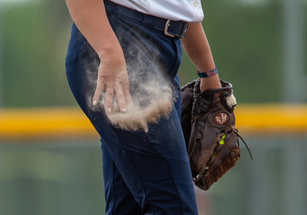 University of Illinois Springfield's Jaycee Craver (9) lets loose a handful of dirt after drying out her hand while pitching in the 8th inning against University of Missouri-St. Louis in the second round of the NCAA Division II Midwest 2 Region Softball Tournament at the Land of Lincoln Junior Olympic Softball Complex, Friday, May 11, 2018, in Springfield, Ill. [Justin L. Fowler/The State Journal-Register]