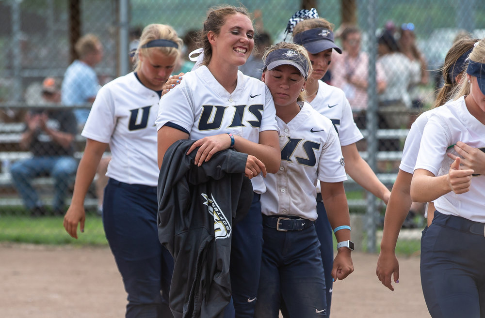 University of Illinois Springfield's Jaycee Craver (9) gets a hug from a teammate after the Prairie Stars were defeated by the University of Missouri-St. Louis 2-0 in the 13 innings in the second round of the NCAA Division II Midwest 2 Region Softball Tournament at the Land of Lincoln Junior Olympic Softball Complex, Friday, May 11, 2018, in Springfield, Ill. [Justin L. Fowler/The State Journal-Register]