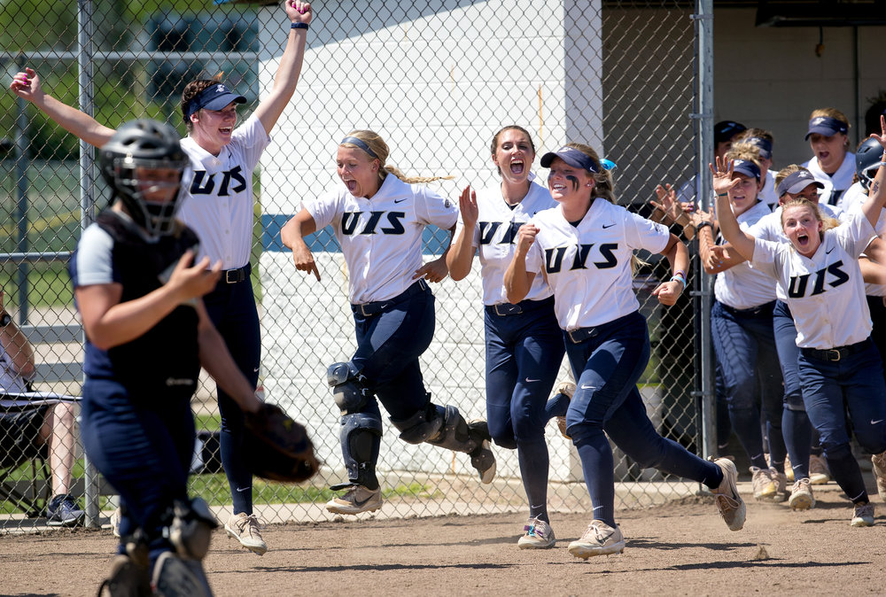 The University of Illinois Springfield Prairie Stars race to home plate to welcome teammate Ali Haesele after she cracked a home run against Saginaw Valley State in the Division II NCAA Softball Tournament Thursday, May 10, 2018. [Ted Schurter/The State Journal-Register] [Ted Schurter/The State Journal-Register]