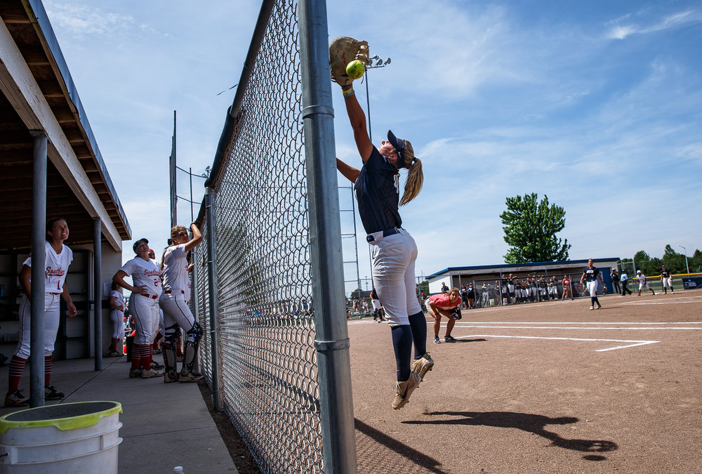 University of Illinois Springfield's Morgan Edwards (4) tries to make a catch on a foul ball in the third inning against University of Southern Indiana during the NCAA Division II Midwest Super Regional at the Land of Lincoln Softball Complex, Thursday, May 17, 2018, in Springfield, Ill. [Justin L. Fowler/The State Journal-Register]
