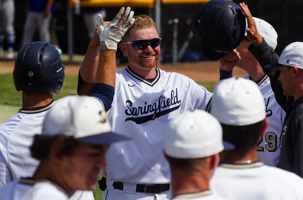 University of Illinois Springfield's Myles Hann collects high fives after belting a homerun against Hillsdale during the Division II NCAA Baseball regional at Robin Roberts Stadium Thursday, May 17, 2018. [Ted Schurter/The State Journal-Register]