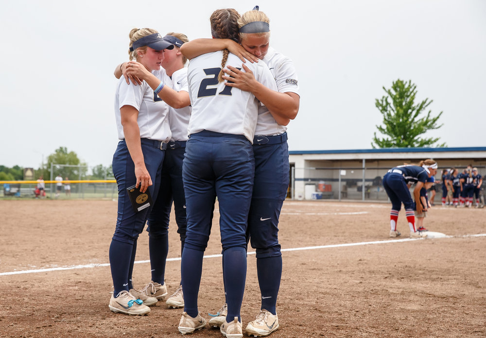 University of Illinois Springfield's Hunter Niebrugge (19) hugs University of Illinois Springfield's Katie Wooldridge (21) after the Prairie Stars were defeated by the University of Southern Indiana 3-0 in game two of the NCAA Division II Midwest Super Regional ending their season at the Land of Lincoln Softball Complex, Friday, May 18, 2018, in Springfield, Ill. [Justin L. Fowler/The State Journal-Register]