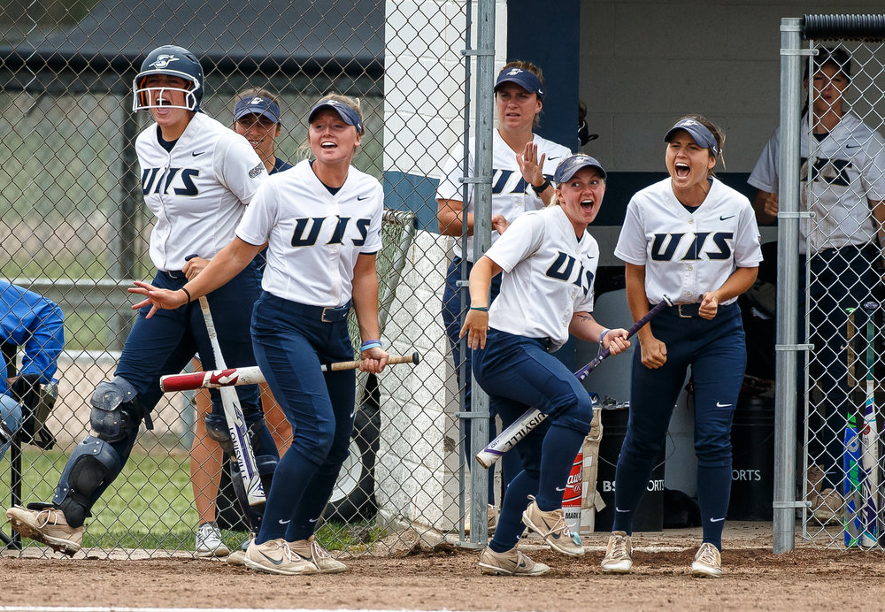 University of Illinois Springfield's Ali Bortmess (1) and University of Illinois Springfield's Natalie Cokel (15) celebrate with the Prairie Stars after University of Illinois Springfield's Haley Inman beat a throw to first on a bunt in the second inning against the University of Illinois Springfield during game two of the NCAA Division II Midwest Super Regional at the Land of Lincoln Softball Complex, Friday, May 18, 2018, in Springfield, Ill. [Justin L. Fowler/The State Journal-Register]
