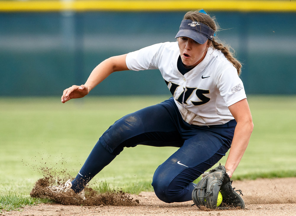 University of Illinois Springfield's Bree Derhake (6) slides through the dirt as she stops a ground ball from the University of Southern Indiana in the fifth inning during game two of the NCAA Division II Midwest Super Regional at the Land of Lincoln Softball Complex, Friday, May 18, 2018, in Springfield, Ill. [Justin L. Fowler/The State Journal-Register]