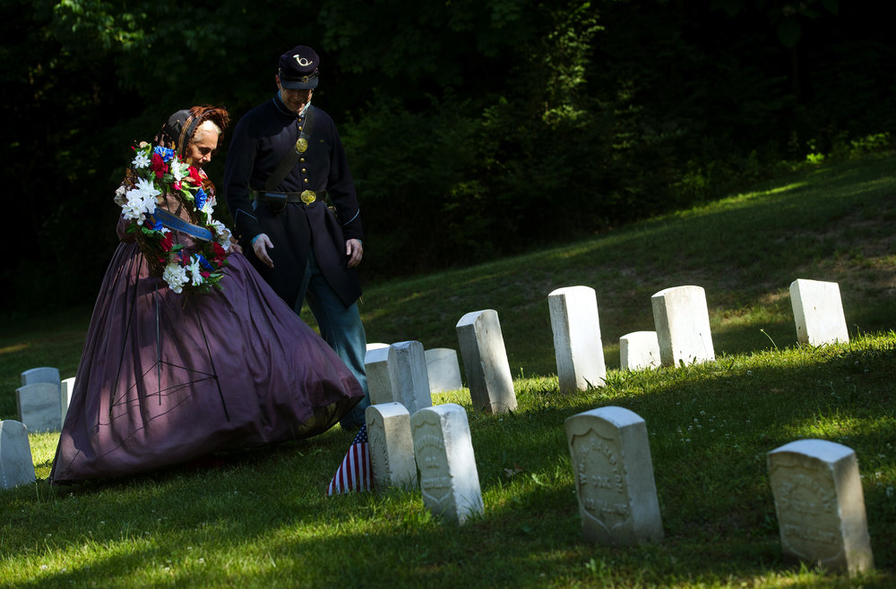 Mary Hudgins with the Soldier's Aid Society is escorted to the Grand Army of the Republic Mound at Oak Ridge Cemetery to place a wreath during Memorial Day ceremonies at Oak Ridge Cemetery Monday, May 28, 2018. [Ted Schurter/The State Journal-Register]