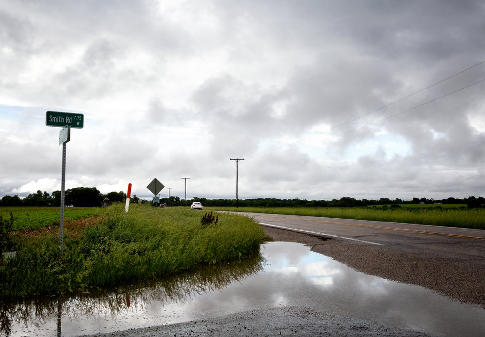 Water sat in farm fields and along roadways in Sangamon County after the remnants of Tropical Storm Alberto delivered 2 to 4 inches of rain overnight to some parts of the area Wednesday, May 30, 2018. According to the National Weather Service at Lincoln, localized amounts totaled as much as 5 inches from just northwest of Springfield to Peoria. At the intersection of Illinois 125 and Smith Road, a puddle reflected the low hanging clouds and occasional glimpses of blue sky. [Rich Saal/The State Journal-Register]