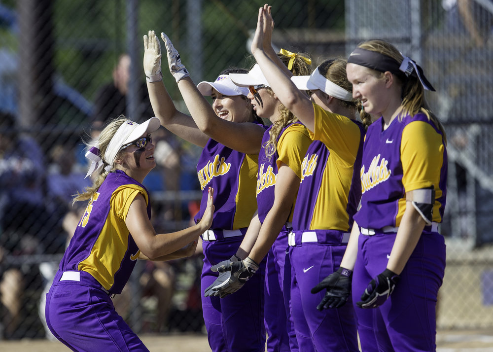 Williamsville's Kaileigh Moser greets her teammates on the field before the Bullets take on Beecer during the Class 2A softball state semifinal at the EastSide Centre in East Peoria Friday, June 1, 2018. [Ted Schurter/The State Journal-Register]