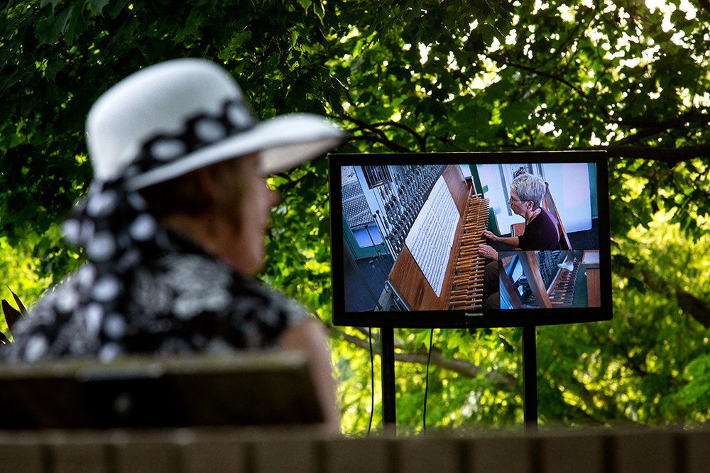 A video monitor allows people listening to watch the carillioneur while they're playing in the Thomas Rees Memorial Carillion at the 57th Annual International Carillon Festival  Monday, June 4, 2018 at Washington Park in Springfield, Ill. [Rich Saal/The State Journal-Register]