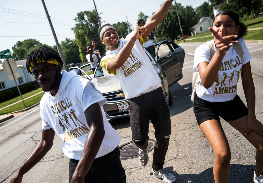 Jazmin Ellis, Victor Mays, center, joined by Jazmin Ellis, right, and Keontay Pollard, left, dance their way north on Martin Luther King Jr. Drive with the dance group Critical Ambition during the parade for the annual Juneteenth Celebration of Freedom at Comer Cox Park, Saturday, June 16, 2018, in Springfield, Ill. [Justin L. Fowler/The State Journal-Register]