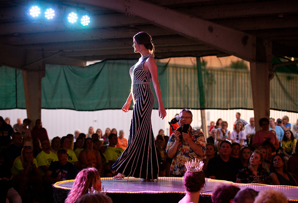 Sara Rotherham on the runway during the evening gown portion of the Sangamon County Fair Queen pageant Tuesday, June 12, 2018 at the Sangamon County Fairgrounds in New Berlin, Ill. Rotherham was named the 2nd runner up in the pageant. [Rich Saal/The State Journal-Register]