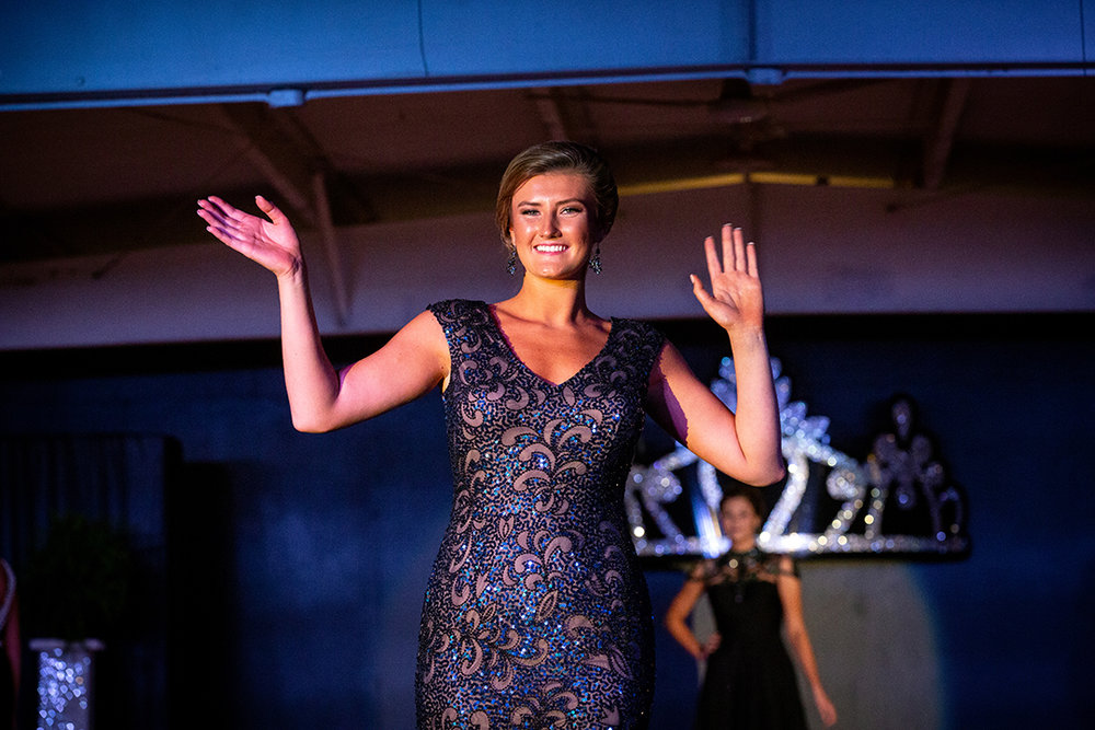 Victoria Zeigler waves to the crowd during the closing portion of the Sangamon County Fair Queen pageant Tuesday, June 12, 2018 at the Sangamon County Fairgrounds in New Berlin, Ill. [Rich Saal/The State Journal-Register]