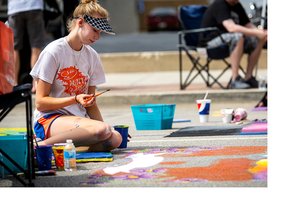 Nichole Kinney, a student at Athens High School, works on her painting depicting the state of Illinois for the bicentennial during the 2018 Paint the Street festival hosted by the Springfield Art Association Saturday, June 23, 2018 on Washington Street in Springfield, Ill. Kinney's painting at last year's event won the People's Choice Award. [Rich Saal/The State Journal-Register]