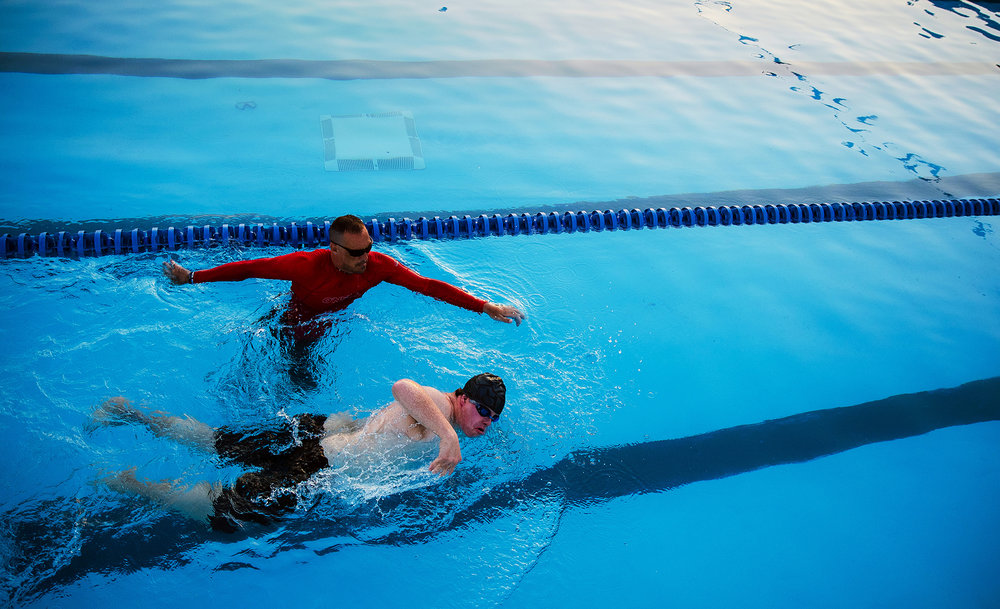 Jonathan Meis is the only one left swimming in the Columbian Aquatic Center as he practices his freestyle stroke under the supervision of Bobby Allison late Monday, June 18, 2018. Meis is representing Illinois in the Special Olympics USA games in Seattle, Wash. in early July. [Ted Schurter/The State Journal-Register]